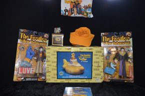 Lot 029 Pick Up Beatles Memorabilia Yellow Submarine: 2 Band Member Dolls Paul and John, Jeremy Hillary Boob Ph.D character,Yellow Submarine Cookie Jar ,Hat,Tee Shirt PICK UP IN ROCKVILLE CENTRE