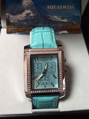 Lot 045 Aquaswiss Watch with Turquoise and Red Leather Bands PICK UP IN GARDEN CITY