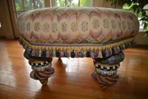 Lot 011 Delivery MacKenzie-Childs Upholstered Tufted Ottoman 31H x 20W x 20D. Materials Ceramic/Fabric/Metal/Upholstery/Wood PICK UP IN PORT WASHINGTON, NY