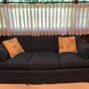 Lot 041 Upholstered Navy Couch. 25Hx35Wx79Long CAN BE PICKED UP IN GARDEN CITY.