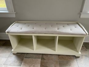 Lot 002 White cushioned storage bench 50in L X 17in W X 20in H PICK UP IN GARDEN CITY 1