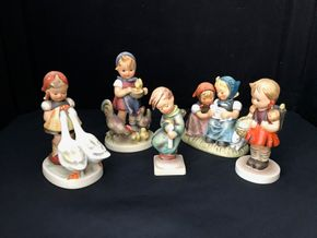 Lot 003 Lot Of Five Hummels. Hummel Girl With Geese 4H Hummel Girl With Chickens 4.5H, Hummel Girls Easter Time Girls With Rabbits 4H, Hummel School Girl With BackpackAnd Basket 5H And Hummel Boy Heavenly Angel Bee Boy With Candle 6H. PICK UP IN STONY BROOK.