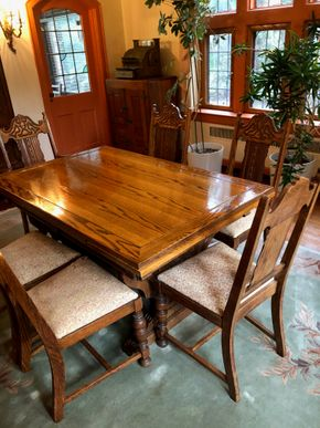 Lot 002 Oak Dining Room w/leaf storage underneath and  Table 6 Oak Dining chairs 2 arms and 4 side chairs PICK UP IN GARDEN CITY
