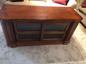 Lot 032 TV Stand 57Wx 24D x 26H ITEM MUST BE PICKED UP IN LONG BEACH