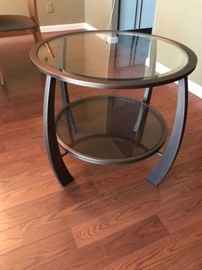 Lot 032 Glass Wood/Metal End Table. 25.5H X 28. PICK UP IN ROCKVILLE CENTRE.