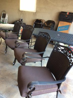Lot 029 LOT OF 4 Cast Iron Outdoor Arm Chairs With Cushions 36Tx 25.5W 27D ITEMS MUST BE PICKED UP IN GARDEN CITY