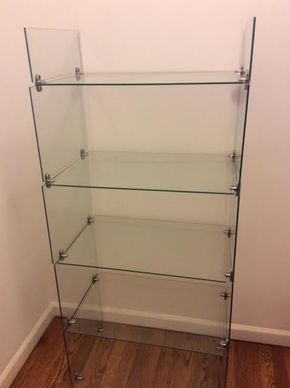 Lot 042 Glass Shelving Unit with 5 Shelves 56Tx 25W x 16D ITEMS MUST BE BICKED UP IN GARDEN CITY