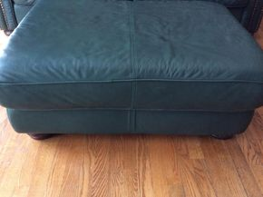 Lot 016 Leather Ottoman 42x16x32 ITEM MUST BE PICKED UP IN GARDEN CITY