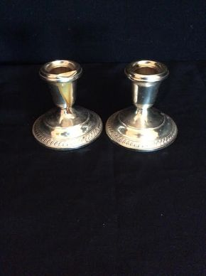 Lot 002 Pair Of Sterling Silver Candle Stick Holders ITEM MUST BE PICKED UP IN WEST HEMPSTEAD