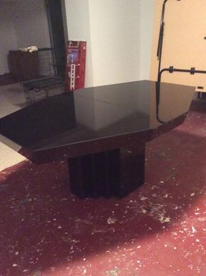 Lot 023 Black Glass Octogon Table With 1 14 Inch Leaf. 71Lx4ftDx30T ITEM MUST BE PICKED UP IN GARDEN CITY