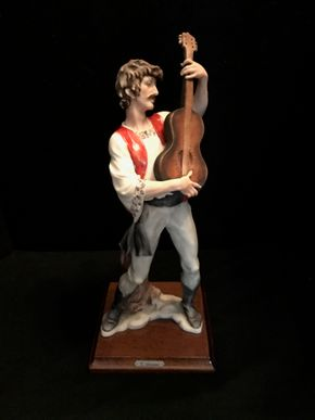 Lot 034 G Armani Man Playing Guitar Figurine. 13.5 In. T. PICK UP IN BELLMORE.