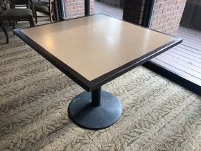Lot 003  36 INCH square table top, Solidz laminate top, with walnut finished eased edge and a round black metal table base -base is worn