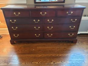 Lot 003 Cherry 9 Drawer Dresser Dimensions Approx. 33H x 64.5W x 19.25D PICK UP IN GARDEN CITY,NY