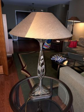 Lot 033 Contemporary Lamp With Leaf. 34.5H. PICK UP IN ROCKVILLE CENTRE.