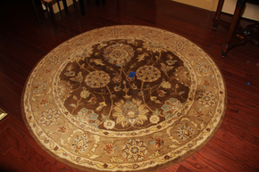 Lot 053 Round Wool Rug 67 inches in diameter ITEMS CAN BE PICKED  UP IN WESTBURY