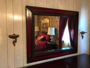 Lot 107 Mahogany Mirror. 41.5H X 1.25W X 51.5L. PICK UP IN BELLMORE.
