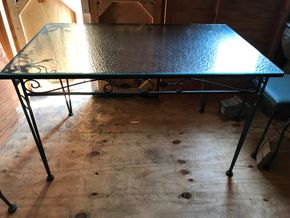 Lot 121 Wrought  Iron Table With Glass Top. 29H X 30.75W X 48.5L. PICK UP IN BELLMORE.