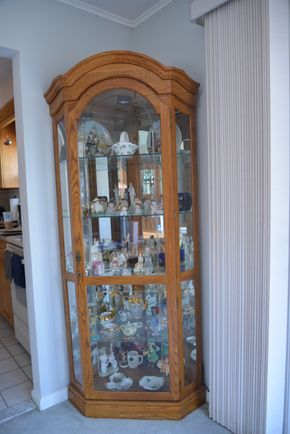 Lot 030 Corner 1-Door Oak Wood Glass Cabinet w/3 Glass Shelves (Contents Not Included)77H x 31W x 15L PICK UP IN SEAFORD, NY