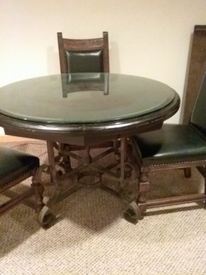 Lot 008 Wood with Iron Base Pedestal table with 2 12 inch leaves 29.5H x 41 In diameter PICK UP IN OCEANSIDE