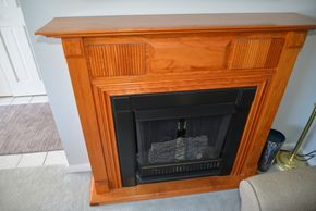 Lot 004 Oak Wood Free Standing Fireplace - use Sterno Candle  44H x 50.5W x 12L  PICK UP IN SEAFORD, NY