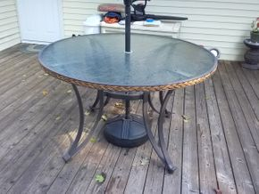 Lot 044 Outdoor Glass Top Round Table 30Hx 49 Diameter PICK UP IN COMMACK